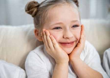 Girl watching TV with interest Zdjęcie Seryjne