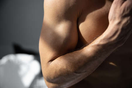 Cropped shot of male muscle body