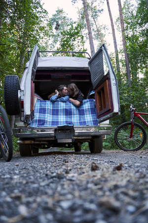Couple embracing into mini van