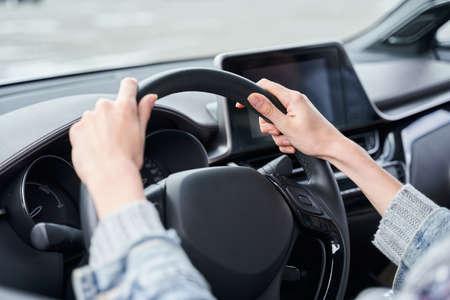 Woman driving a car 写真素材