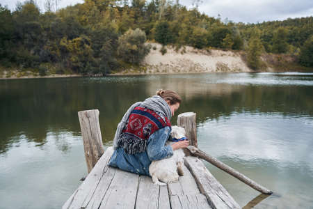 Woman admiring the nature with her dog
