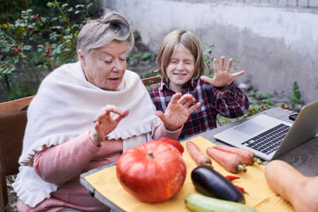 Child and his grandmother preparing for the Halloween