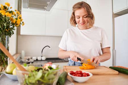 Woman preparing vegetables for the future salad Archivio Fotografico