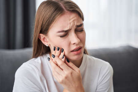 Women suffering from toothache