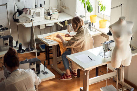 Seamstress in textile factory