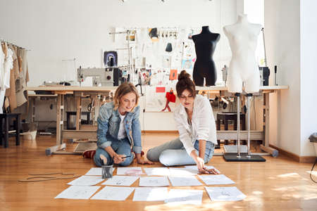 Girls sketching for the future collection of clothes