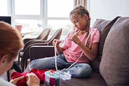 Girl examines measuring type Stok Fotoğraf