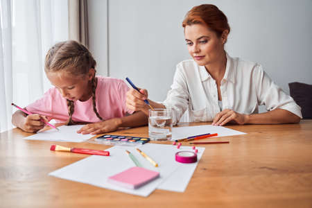 Mother and daughter drawing colorful pencils Stok Fotoğraf