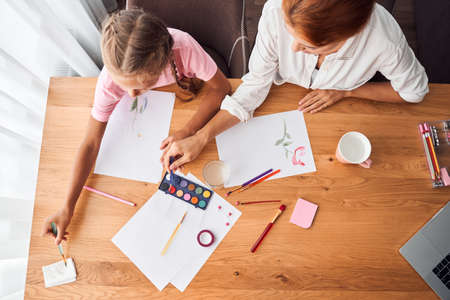 Mom drawing pictures with daughter