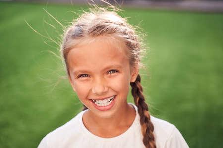 Portrait of sweet little girl outdoors