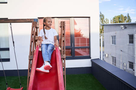 Children sitting at the slide