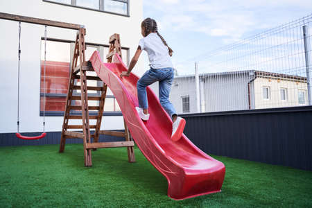 Child running up the slide