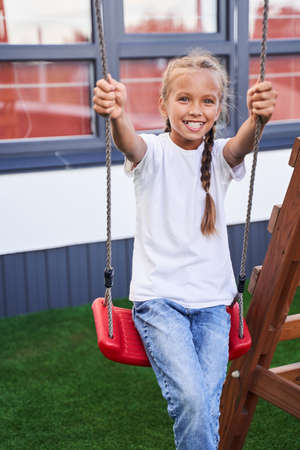Girl smiling at the swing Stok Fotoğraf