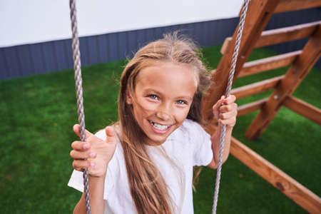 Girl swinging at the swing