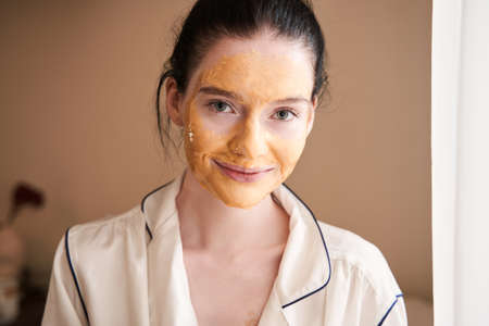 Woman with vitiligo using a face mask