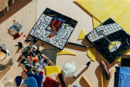 Designer working of new mosaics while spending time at her modern studio