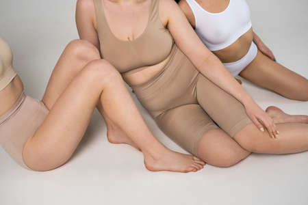 Three girls in underwear sitting in front of the camera