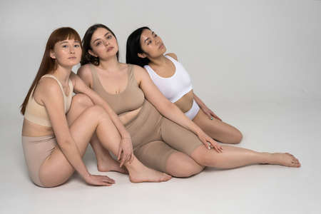 Women of different height, figure type and size dressed in underwear