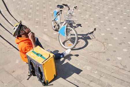 Delivery man preparing to giving package to customer Stock fotó