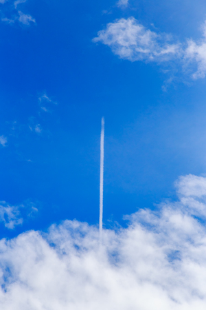 contrail: abstract contrail cloud on the blue sky