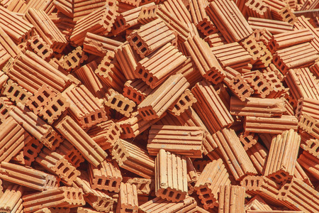 red brick repetition: pile of red brick texture background Stock Photo