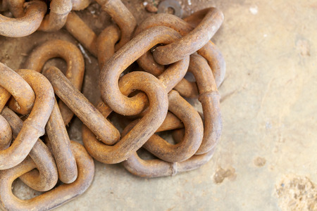 rusty chain: rusty iron chain on concrete floor