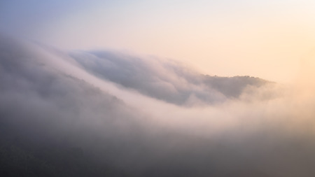 panoramic nature: mountain and fog in the morning Stock Photo