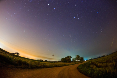 starry night sky: abstract long exposure photography of Geminid Meteor in the starry night sky Stock Photo