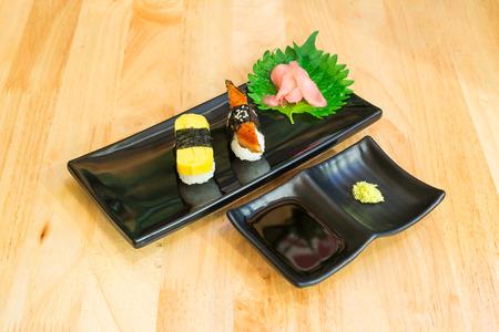 egg roll: tamakoyaki or egg roll sushi and unagi or grilled eel sushi set