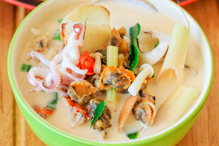 seafood soup: coconut spicy seafood soup thai food call Tom Kha Ta-lay Stock Photo