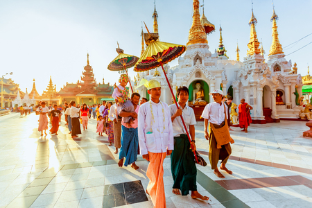 important event: YANGON, MYANMAR - DEC 20 : The Shinbyu or novitiation ceremony at the Shwedagon Pagoda DEC 20 2014 Myanmar.The Shinbyu ceremony is one of the most important event in a Buddhists life in Myanmar.