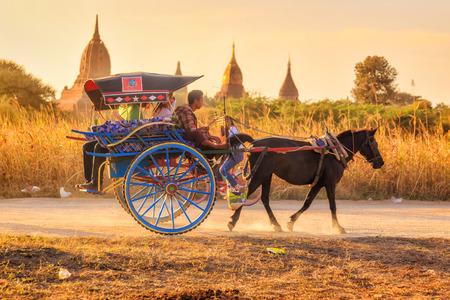 Bagan, MYANMAR - DEC 21: horse carriage at Shwesandaw temple at the archaeological site of Bagan, Myanmar on December 21, 2014