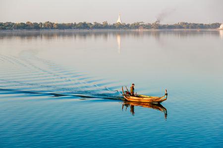 Mandalay, U Bein Bridge, Myanmar - DEC 22 : The Burmese boatman taking tourist for sightseeing at U Bein bridge, Taung Tha Man Lake in Amarapura, Mandalay, Myanmar DEC 22 2014. Editorial