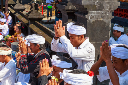 performed: UBUD, BALI, INDONESIA - MARCH 28 : people praying in Melasti Ritual is performed before Nyepi - a Balinese Day of Silence on March 28, 2014 in Ubud, Bali, Indonesia.