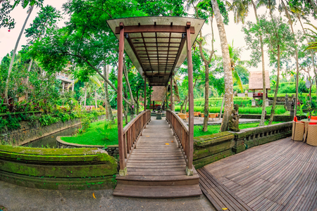 wooden foot path with roof, fish eye lens view