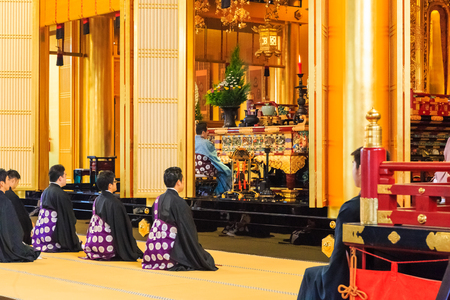 priest's ritual robes: Tokyo, Japan - October 18, 2016 : preist praying in ritual of Tsukiji Honganji Temple in Tokyo, Japan on October 18, 2016