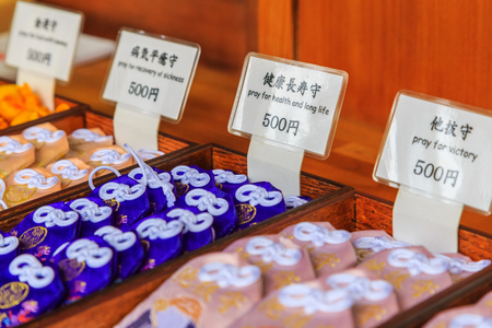 Tokyo, Japan - October 19, 2016 : Japanese charm blessing in many way selling at Toshogu shrine in Ueno Park in Tokyo, Japan. Editorial