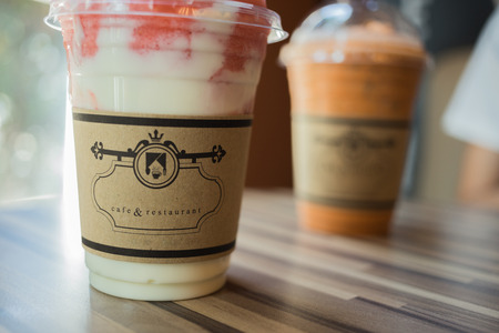 blends: Front cup is yogurt smoothies shake with strawberry and behind cup is milk tea cold Stock Photo