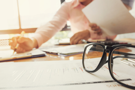 Administrator business man financial inspector and secretary making report, calculating or checking balance. Stock Photo