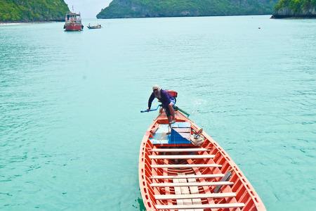 ang thong: Man on boat at National park Ang Thong Island