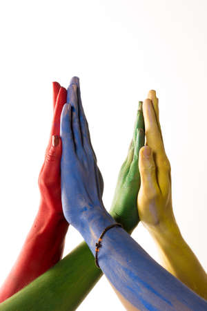 Colourful hands joined together Stock Photo