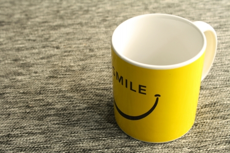 Yellow smiling cup Stock Photo