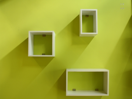 White shelf on a green wall photo