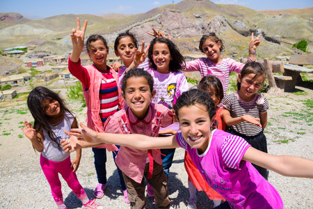 Van, Turkey-July 7, 2015: Happy Kurdish girls are smiling and posting for pictures in front of Hosap castle in Van