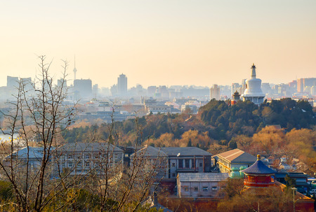 View over Beihai park in late afternoon with Beijing skyline as a background Stock Photo