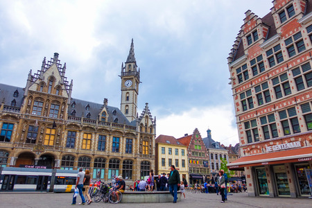 Ghent, Belgium-June 12, 2016: Old post office building with the clock tower and medieval buildings in the old town of Ghent Editorial