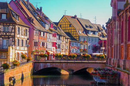 the little venice: Beautiful late summer afternoon view of traditional colorful half-timbered buildings in the historical old town of Colmar, Alsace wine region in France Stock Photo