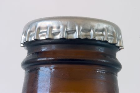 Close-up of the top of a beer bottle, unopened. Stock Photo