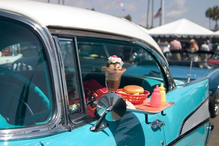 Classic car with food tray attached to the driver's window. Stock Photo - 249070