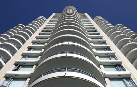 apartment market: Perspective view of a white apartment building.